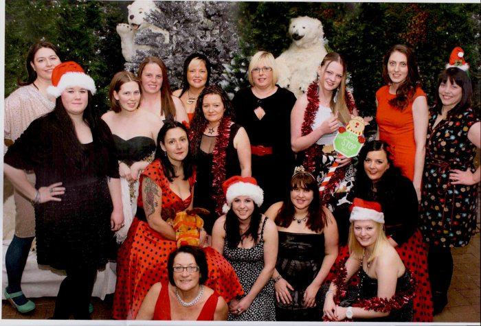 A Christmas-themed group photo from the Lothian Derby Dolls 2013 calendar.