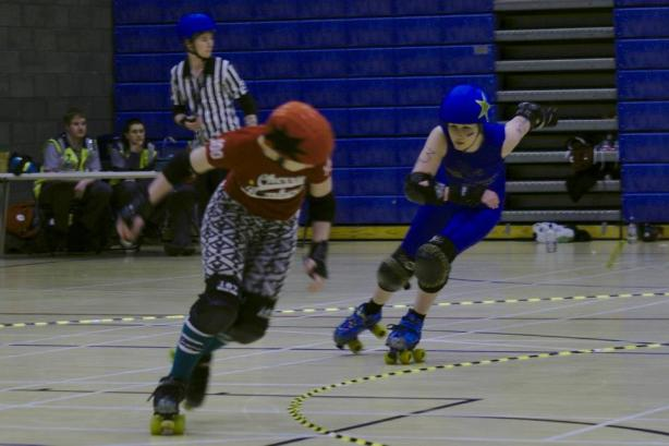 Ciderella chases down Circuit Breaker in one of the several jammer-on-jammer duels in the bout.